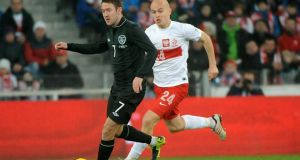 Aiden McGeady  of Ireland holds off the challenge of Poland's Michal Pazdan. Denis Irwin though the winger was Irelland's only bright spark on the evening