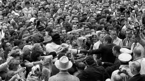 Kennedy reaches out to the crowd gathered at the Hotel Texas Parking Lot Rally in Fort Worth,Texas, on November 22nd, 1963. Photograph: Cecil Stoughton/The White House/John F. Kennedy Presidential Library