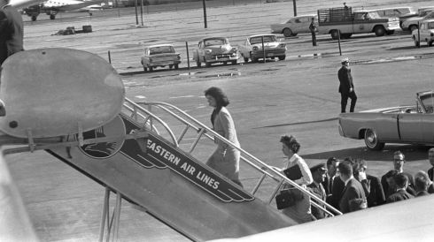 Jacqueline Kennedy (L), widow of former US president John F. Kennedy, boards Air Force One at Love Field following his assassination in Dallas. Photograph: Cecil Stoughton/The White House/John F. Kennedy Presidential Library/Reuters