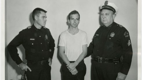 Lee Harvey Oswald, accused of assassinating former US president John F. Kennedy, is pictured with Dallas police Sgt. Warren (r) and a fellow officer in Dallas. Photograph: Dallas Police Department/Dallas Municipal Archives/University of North Texas