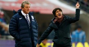 Germany's coach Joachim Löw (right) celebrates next to England's manager Roy Hodgson after the  friendly  at Wembley Stadium. Photograph: Eddie Keogh/Reuters