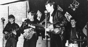 "'Geoff Rhind points out that the Fab Four had many Irish connections and wonders why ""Ireland never really claimed the Beatles"" because, as he says, they belonged to ""The Liverpool Irish"".' Above, the Beatles perform in a club prior to signing their first recording contract. From left,  George Harrison, John Lennon, Paul McCartney, and original drummer Pete Best. Photograph:  Hulton Archive/Getty Images"