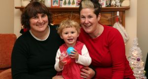 Charlotte McCallum Mallard (right) and her wife Beth Mallard and their 22-month-old daughter Lola, at home in Galway. Photograph: Joe O'Shaughnessy