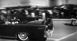 The limousine carrying mortally wounded President . Kennedy races toward the hospital seconds after he was shot in Dallas. Photograph: Justin Newman/AP