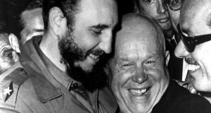 Cuban president Fidel Castro and Soviet leader Nikita Khrushchev hug at the United Nations in this late 1960's file photo. Photograph: Marty Lederhandler/AP