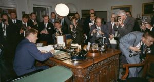 President Kennedy signs a proclamation for the interdiction of the delivery of offensive weapons to Cuba at the White House on October 23rd, 1962.