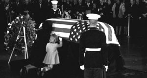 Jackie Kennedy kisses the casket of her husband in the rotunda of the US Capitol on November 24th, 1963. Daughter Caroline kneels alongside. Photograph: AP