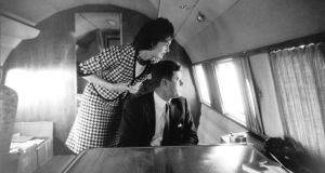 Jacqueline Kennedy and John F. Kennedy when he was still a senator,  aboard an aircraft arriving in California in 1960 during the primary campaign. Photograph: Jacques Lowe/AP