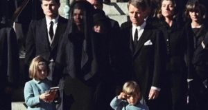 Three-year-old John F Kennedy Jr salutes his father's casket in Washington on November 25th, 1963. Jackie Kennedyand daughter Caroline Kennedy are accompanied by the late president's brothers  Edward Kennedy and attorney general Robert Kennedy. Photograph: AP