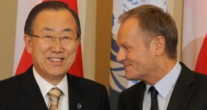 Polish Prime Minister Donald Tusk (R) and UN Secretary General Ban Ki-moon (L) pose for the media during a meeting in Warsaw, Poland