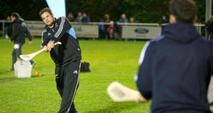 All Blacks captain Richie McCaw tries his hand at hurling with Dublin's Bernard Brogan during the AIG-hosted Dublin GAA and New Zealand All Blacks'  Unique Skills Challenge at Westmanstown Sports and Conference Centre in Clonsilla, Co Dublin. Photograph: Morgan Treacy/Inpho