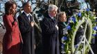 US President Barack Obama (2-L), first lady Michelle Obama (L), former US president Bill Clinton (2-R) and former secretary of state Hillary Clinton lay a wreath at the gravesite for president John F Kennedy at Arlington National Cemetery in Arlington, Virginia, USA. Photograph: EPA/Pat Benic/Pool