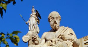 Socrates with Athena looking over his shoulder in Athens