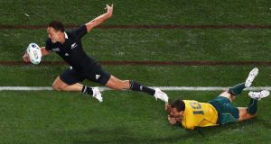 Quade Cooper of the Wallabies fails to stop Israel Dagg of the All Blacks as he breaks forward during the World Cup semi-final  at Eden Park  in Auckland in October 2011. Photograph: Ryan Pierse/Getty Images