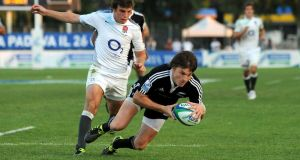 Beauden Barrett of New Zealand scores a try during the IRB Junior World Championship final against England in 2011. Barrett is one of nine from that team on the senior All Blacks squad. Photograph: Valerio Pennicino/Getty Images