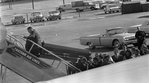 The casket holding JFK's remains is loaded aboard Air Force One at Love Field in Dallas, Texas. Photograph: Cecil Stoughton/John F Kennedy Presidential Library/Reuters