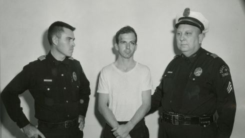 Lee Harvey Oswald, accused of assassinating JFK, is pictured with Dallas police. Photograph: Dallas Police Department/Dallas Municipal Archives/University of North Texas/Reuters