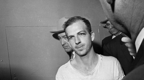 Lee Harvey Oswald is led down a corridor of the Dallas police station for another round of questioning in connection with the killing. Photograph: AP Photo