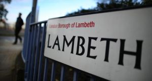 A man walks near a road sign in Lambeth, London, today.  British police have reported that three women who have allegedly been held for 30 years as slaves in a house in the Lambeth area of south London have been freed. Photograph:  Peter Macdiarmid/Getty Images