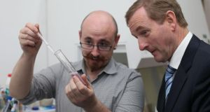 Test-tube trials: scientist Conor Courtney shows Taoiseach Enda Kenny a DNA extraction experiment at the Science Gallery in Trinity College, Dublin. Photograph: Niall Carson/PA Wire