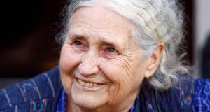 Doris Lessing on the doorstep of her London home after being told she had won the Nobel Prize for literature in October 2007.  Photograph:  Reuters