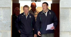 Head coach Joe Schmidt and press officer David O Siochain make their way into today's press conference, followed by team manager Mick Kearney (left) and captain Paul O'Connell. Photograph: Dan Sheridan/Inpho