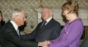 President Michael D Higgins and his wife, Sabina, with former US ambassador Dan Rooney at a reception for members of the diplomatic corps at Áras an Uachtaráin last year. Photograph: Alan Betson