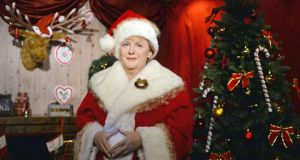 A wax figure of German chancellor Angela Merkel as Santa Claus  at  Madame Tussauds  in Berlin. Photograph:  Jens Kalaene/EPA