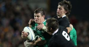 Brian O'Driscoll is tackled by New Zealand captain Richie McCaw and Beauden Barrett during Ireland's 60-0 loss in Hamilton in June of last year.