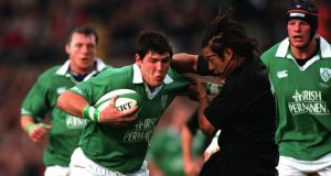 Shane Horgan of Ireland and Tana Umaga of New Zealand. Photograph: Patrick Bolger/Inpho