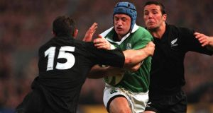 David Humphreys of Ireland is tackled by Leon McDonald and Aaron Mauger of New Zealand. Photograph: Patrick Bolger/Inpho