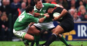 Jonah Lomu of New Zealand is tackled by Shane Horgan and Brian O'Driscoll of Ireland at Lansdowne Road in 2001. Photograph: Patrick Bolger/Inpho