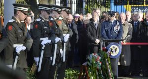 Tánaiste Eamon Gilmore and Stuart Dwyer, US charge d'affaires, lay wreaths during a ceremony at the US embassy in Ballsbridge, Dublin, to commemorate the 50th anniversary of the death of President John F Kennedy in Dallas. Photograph: Alan Betson / The Irish Times