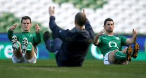 Jonathan Sexton and Rob Kearney warm up during today's Captain's Run at the Aviva Stadium. Photograph: Dan Sheridan/Inpho