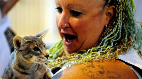Judge P Hutchinson with Ollie, a Blue Spotted Oriental. Photograph: Rui Vieira/PA Wire