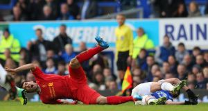 Luis Suarez is fouled by Kevin Mirallas during today's match. Photograph: Alex Livesey/Getty Images