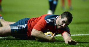 Damien Varley of Munster goes over for his try. Photograph: Ben Evans/Inpho
