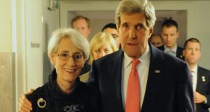 A handout picture provided by the US Department of State shows US secretary of state John Kerry (right) embracing under secretary of state for political affairs Wendy Sherman after sic nations concluded a nuclear deal with Iran in Geneva, Switzerland, this morning. Photograph: EPA