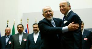 Iranian foreign minister Mohammad Javad Zarif (second right) hugs French foreign minister Laurent Fabius after a ceremony at the United Nations in Geneva this morning. Photograph: Reuters