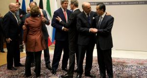 British foreign secretary William Hague (left), Germany's foreign minister Guido Westerwelle (third right), EU high representative for foreign affairs and security policy Catherine Ashton (fifth right), Iranian foreign minister Mohammad-Javad Zarif (not pictured), Chinese foreign minister Wang Yi (right), US secretary of state John Kerry (fourth right), Russian foreign minister Sergey Lavrov (not pictured), French foreign minister Laurent Fabius (second left), are seen during a ceremony at the UN in Geneva after the Iran deal was reached.  Photograph: EPA