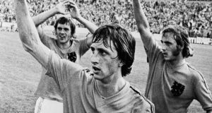 Dutch footballers (from left) Johnny Rep, Johan Cruyff, and Johan Neeskens wave to the crowd  before taking on West Germany in the 1974 World Cup Final. Photograph: Getty Images.