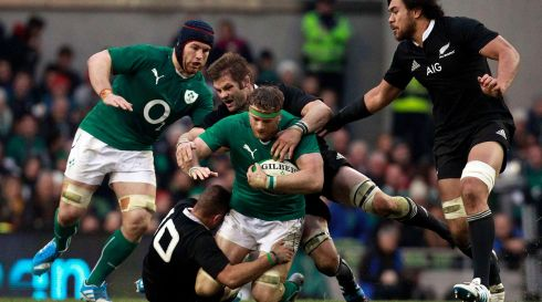 Ireland's Jamie Heaslip with New Zealand's Aaron Cruden (second left) and Richie McCaw. Photograph: Cathal McNaughton/Reuters