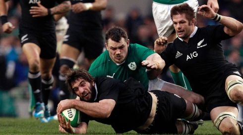 New Zealand's Samuel Whitelock (bottom) is challenged by Ireland's Cian Healy. Photograph: Cathal McNaughton/Reuters