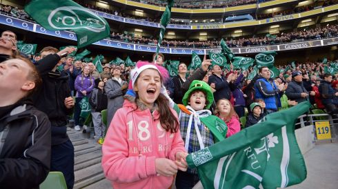 Sadhbh Murphy (10) and her brother Oscair (8) , from Hollywood, Co Wicklow, on his birthday, cheering on Ireland in the match with New Zealand. Photograph:  Eric Luke /The Irish Times