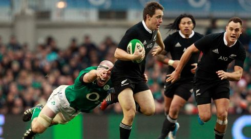 New Zealand's Ben Smith (centre) is challenged by Ireland's Paul O'Connell (left). Photograph: Cathal McNaughton/Reuters