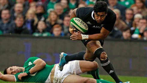 New Zealand's Julian Savea goes over for a try as Ireland's Conor Murray looks on.  Photograph: Cathal McNaughton/Reuters