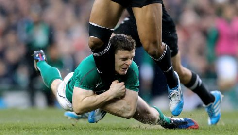 Ireland's Brian O'Driscoll tackles Julian Savea of New Zealand. Photograph: James Crombie/Inpho
