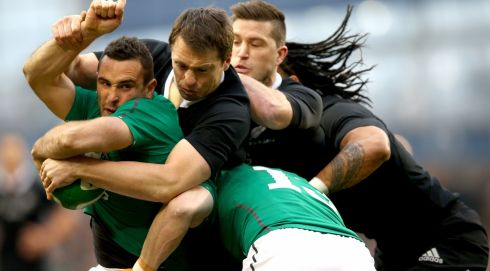 Dave Kearney of  Ireland is tackled by Ben Smith, Cory Jane and Ma'a Nonu of the All Blacks.   Photograph: Phil Walter/Getty Images
