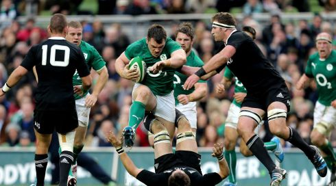 Ireland's Cian Healy runs at Richie McCaw of New Zealand. Photograph: James Crombie/Inpho