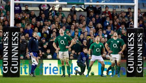 Ireland players look on as New Zealand's Aaron Cruden converts a try to win the match in injury time. Photograph: Cathal McNaughton/Reuters